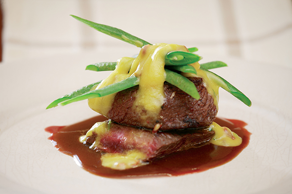 Ostrich Fillet Topped With Beans And Served With Two Sauces